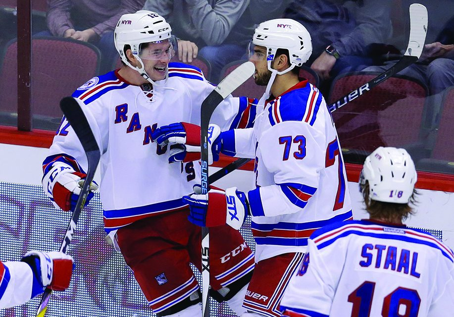 Puempel gets power-play hat trick, Rangers hold off Coyotes