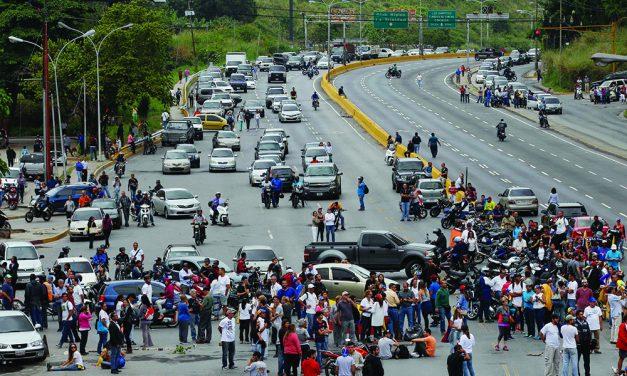 Venezuelans block roads to  protest Maduro constitution call
