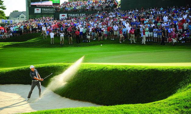 Spieth holes bunker shot to win Travelers playoff