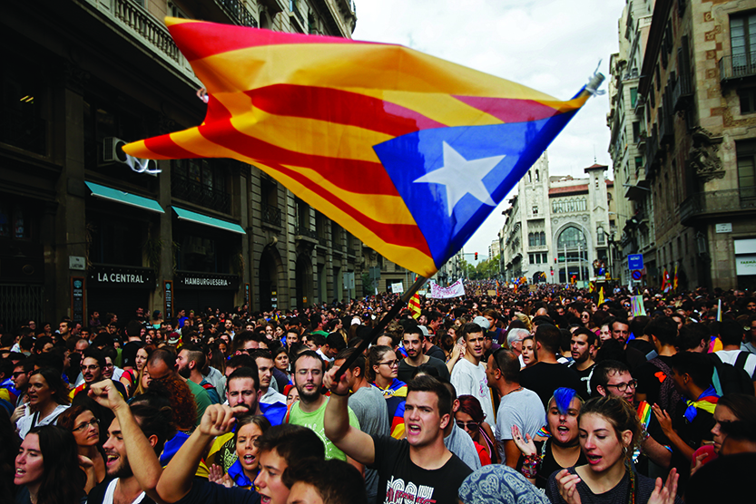 Catalans stop work to protest  police force during referendum