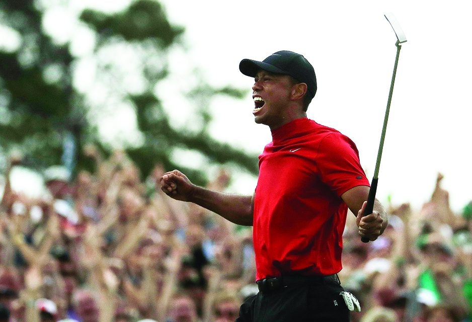 Tiger a major champ again, and race to Nicklaus back on